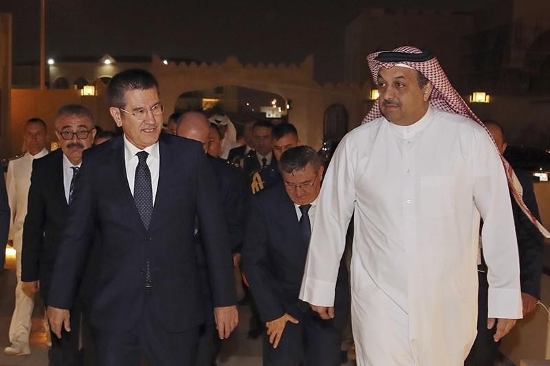 Turkey's Defence Minister Nurettin Canikli, left, walks with his Qatar's counterpart Khalid bin Mohammed al-Attiyah, right, following their meeting in Doha, Qatar, Saturday, Nov. 4, 2017. (AP Photo)