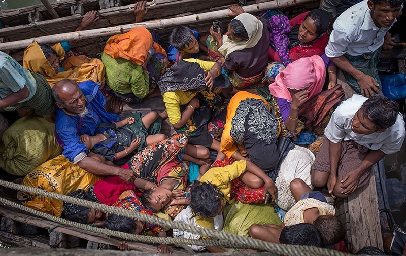 This photograph taken on Sept. 12, 2017, shows Rohingya refugees arriving by boat at Shah Parir Dwip on the Bangladesh side of the Naf River after fleeing violence in Myanmar. (AFP Photo)