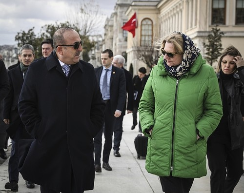 The two foreign ministers speak as they walk along the Bosporus before official talks and a joint press conference in Istanbul, Thursday, Jan. 25, 2018. (AP Photo)