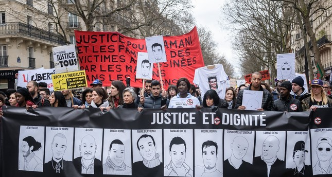 Demonstrators march with posters of their relatives killed or injured during a protest against police's violence in Paris, France, 19 March 2017. (EPA Photo)