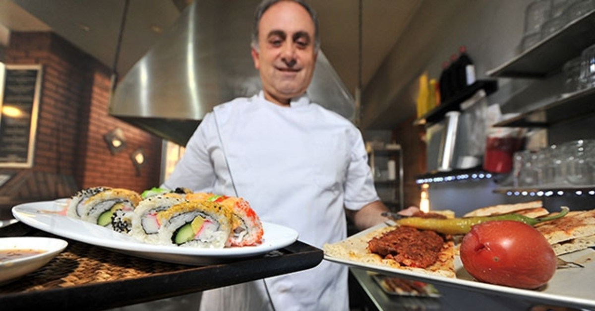 Turgay Kahraman offers sushi and kebab in his restaurant.