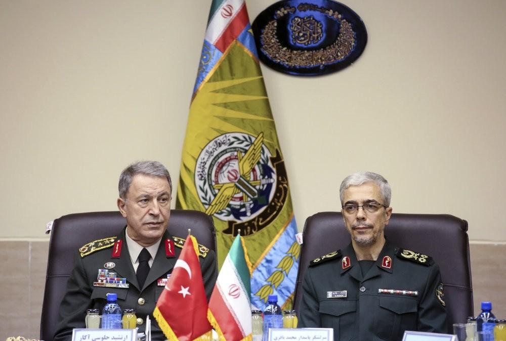 Turkey's Chief of General Staff Gen. Hulusi Akar (left) and Iran's Chief of Staff Lt. Gen. Mohammad Hossein Bahgeri at a meeting in Tehran last month.