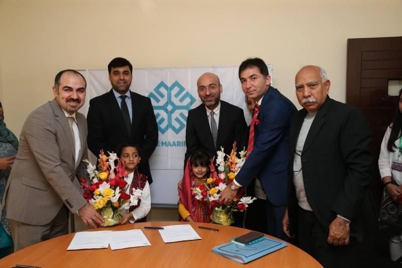 Pakistani and Maarif Foundation officials after signing the documents which marked the official handing over of FETu00d6-linked schools to Turkey, Jan. 16, 2018. (AA Photo)