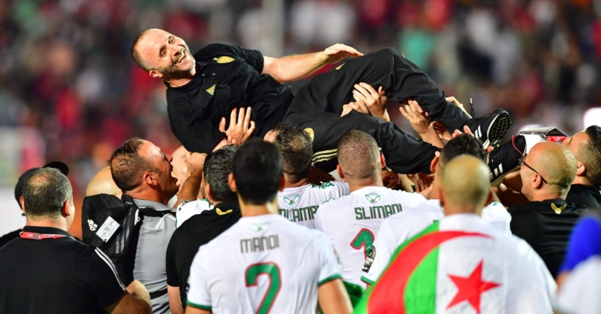 Algeria's coach Djamel Belmadi celebrates after winning the 2019 Africa Cup of Nations (CAN) Final football match between Senegal and Algeria at the Cairo International Stadium in Cairo on July 19, 2019. (AFP Photo)