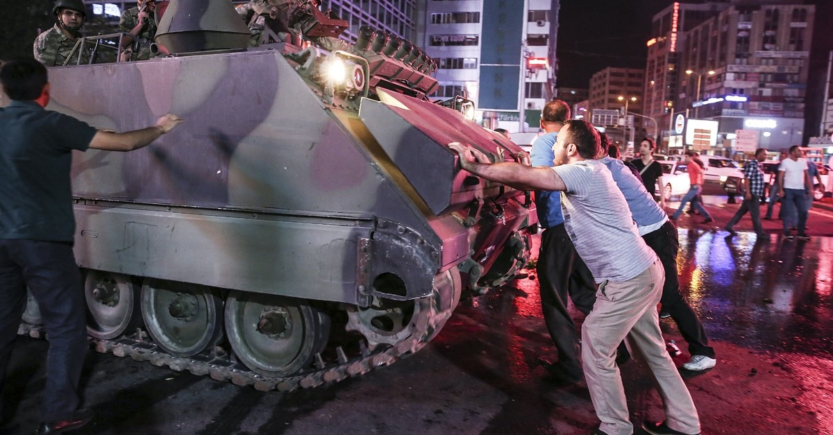 People try to stop a tank dispatched by putschists in Ankarau2019s Ku0131zu0131lay Square on July 15, 2016. Ali Kalyoncu, one of the fugitives, is accused of dispatching tanks  to Ankarau2019s streets against anti-coup civilians.