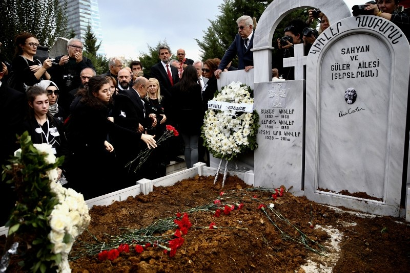 Mourners leave flowers on the grave of Turkish photographer Güler at Şişli Armenian cemetery.