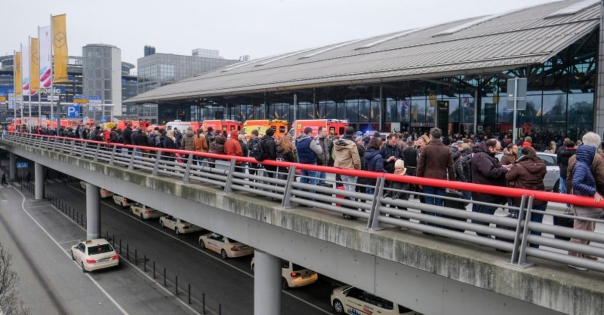 Travelers wait outside the Hamburg, northern Germany, airport Sunday, Feb. 12, 2017 (AP Photo)