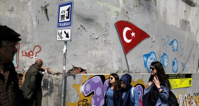 People walking near an underground passage in the Karaköy district of Istanbul, April 17, the day after the constitutional referendum.
