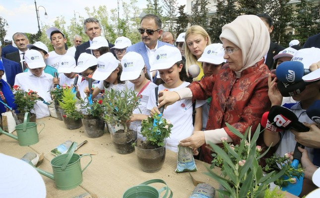 First lady Emine Erdoğan plants flowers using compost made of recycled waste at an event at the Presidential Complex, June 2018.