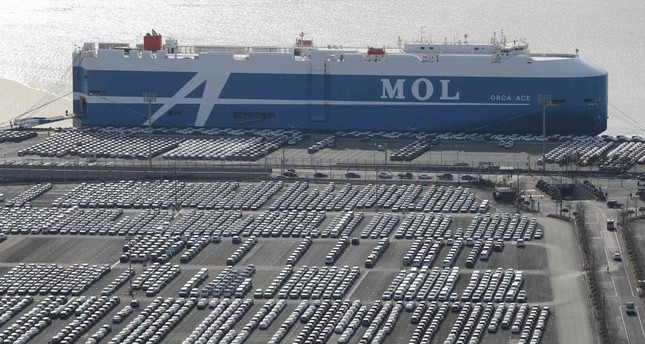 This Feb. 6, 2020, photo shows rows of Hyundai cars parked for shipping in the southeastern port of Ulsan, South Korea. Yonhap via AFP