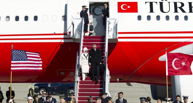 President Recep Tayyip Erdoğan accompanied by his wife Emine walk down the stairs upon his arrival at Andrews Air Force Base, Md., Tuesday, March 29, 2016. (AP Photo)