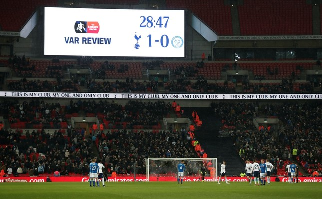 The big screen displays that a decision has been referred to VAR (Video Assistant Referee) during the FA Cup Fifth Round match between Tottenham Hotspur vs Rochdale at the Wembley Stadium, London.