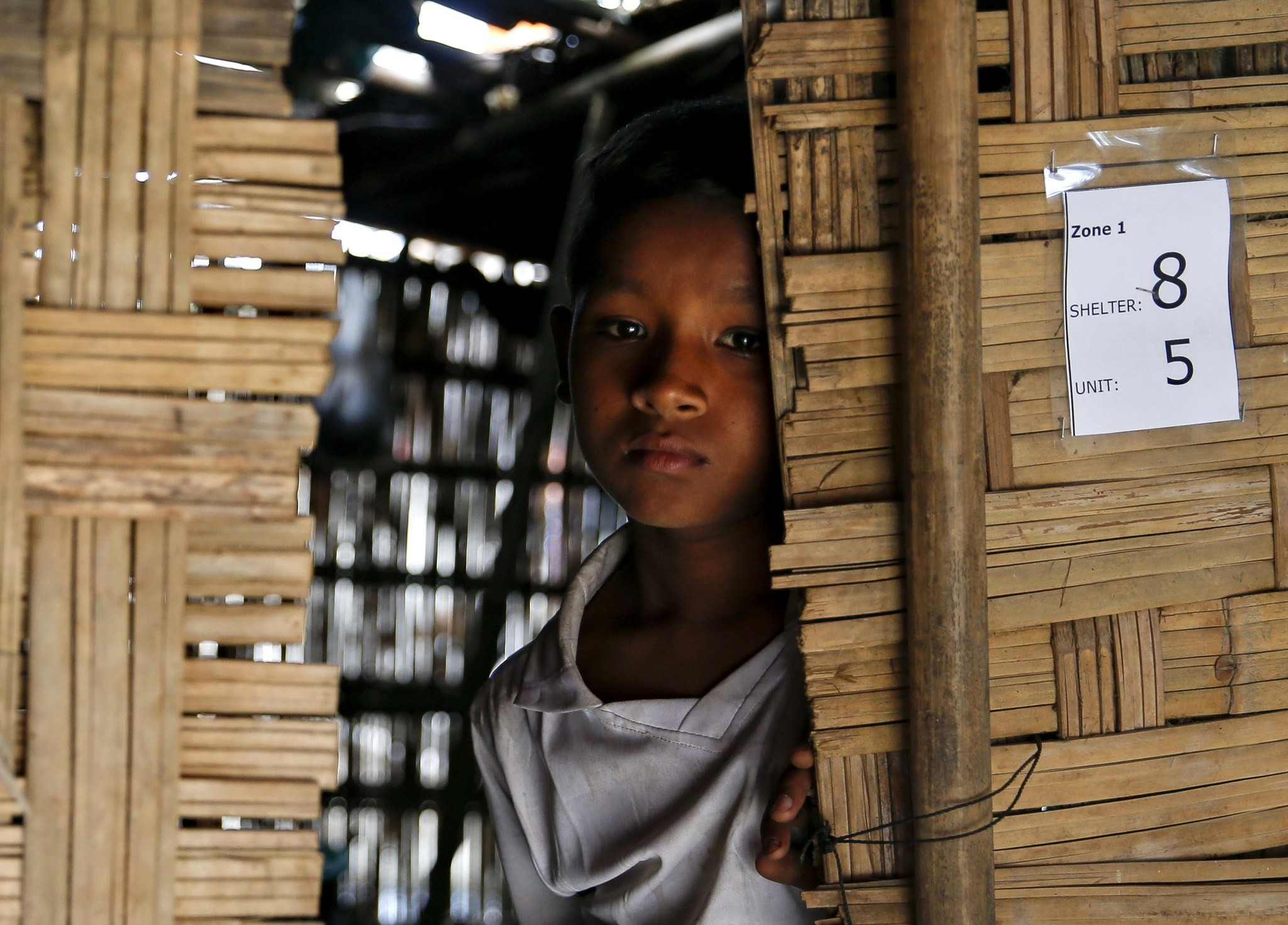 Nabeel Hyseub, 10, a Muslim Rohingya boy, stands inside a shelter at Thet Kel Pyin, an internally displaced person (IDP) camp, in Rakhine State.