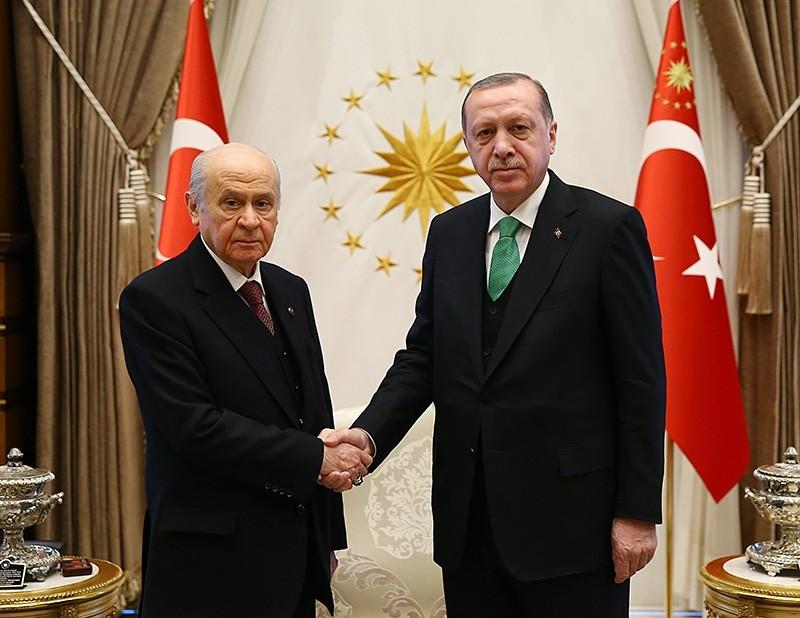 President Recep Tayyp Erdou011fan (R) shakes hands with MHP Chairman Devlet Bahu00e7eli. (AA Photo)