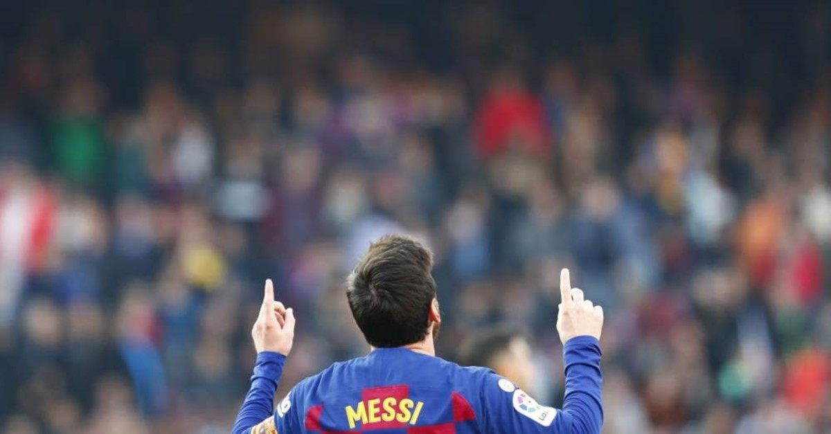Barcelona's Lionel Messi celebrates after scoring his side's second goal during a Spanish La Liga soccer match between Barcelona and Eibar at the Camp Nou stadium in Barcelona, Spain, Saturday Feb. 22, 2020. (AP Photo)