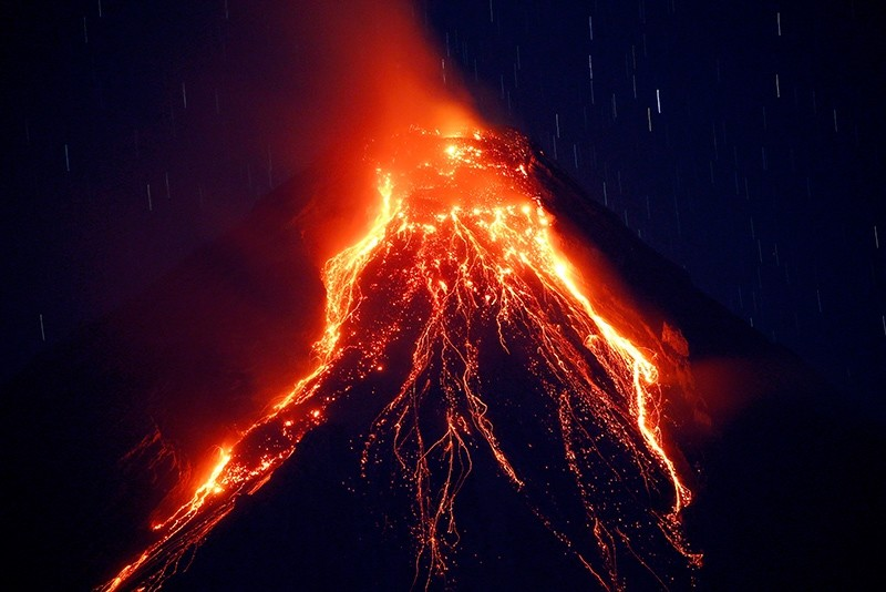 Lava cascades down the slopes of Mayon volcano during its eruption for the second straight day Tuesday, Jan. 23, 2018 as seen from Legazpi city, Albay province, southeast of Manila, Philippines. (AP Photo)