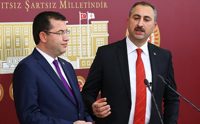 MHP deputy Parsak L and AK Party deputy Gül hold a press conference on constitutional reform draft in Turkey's Parliament. AA Photo