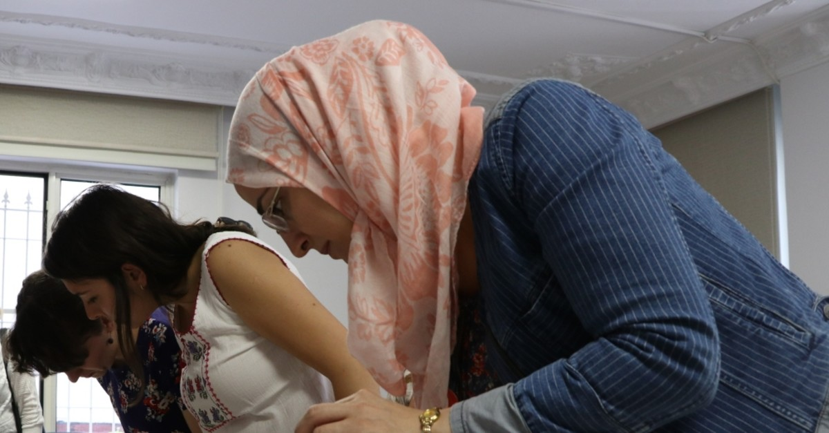 Turkish and Syrian women work together to learn different branches of art at the workshop in Gaziantep.