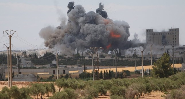 Smoke and flames rise after what SDF fighters said were U.S.-led airstrikes on mills in Manbij where DAESH militants are positioned in Aleppo Governorate, Syria, June 16.