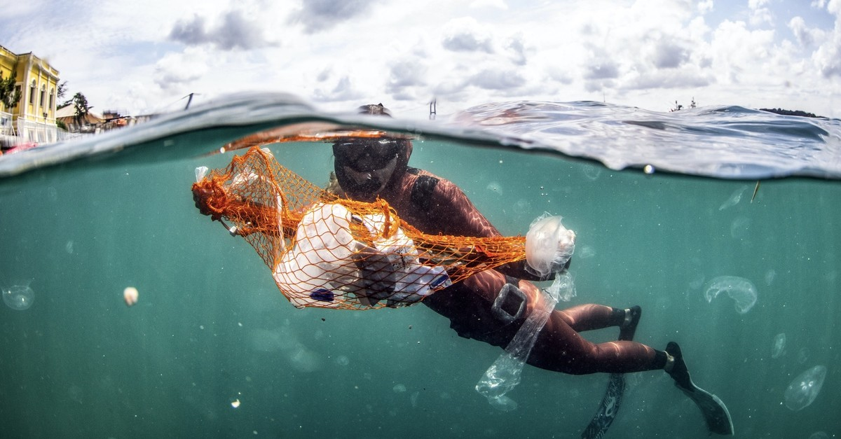 Free-diving world record holder u015eahika Ercu00fcmen collects waste at sea during the launch of Zero Waste Blue in Istanbul, June 11, 2019.
