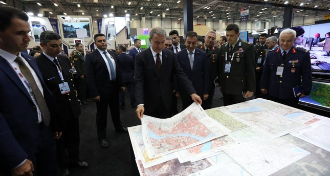 Defense Minister Hulusi Akar visits the stand of National Defense University (MSÜ) at the IDEF'19 defense fair in Istanbul, on May 5, 2019. (AA Photo)