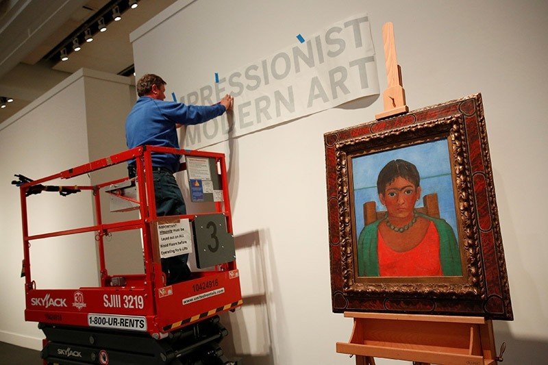 Frida Kahlo's painting 'Nina Con Collar' sits on an easel at Sotheby's auction house in New York U.S. (Reuters Photo)