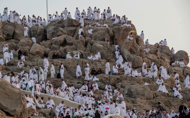 Muslim pilgrims gather at the Jabal Al Rahma holy mountain, or the mountain of forgiveness, at Arafat for the annual Hajj pilgrimage outside the holy city of Mecca, Saudi Arabia, Monday, Aug. 20, 2018. (AP Photo)