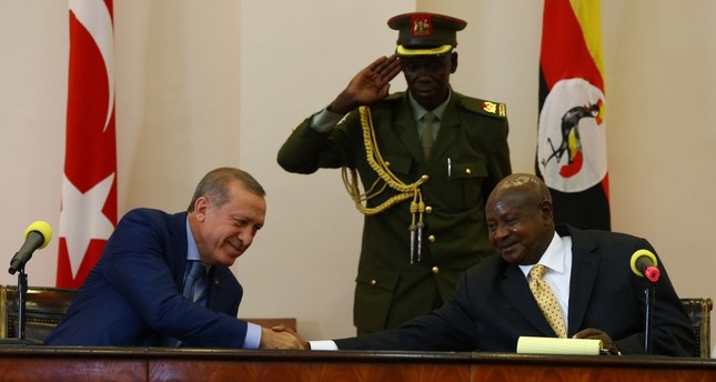 Erdoğan (L) shakes hands with his Ugandan counterpart Museveni (R) at a press conference held in Kampala on Wednesday.