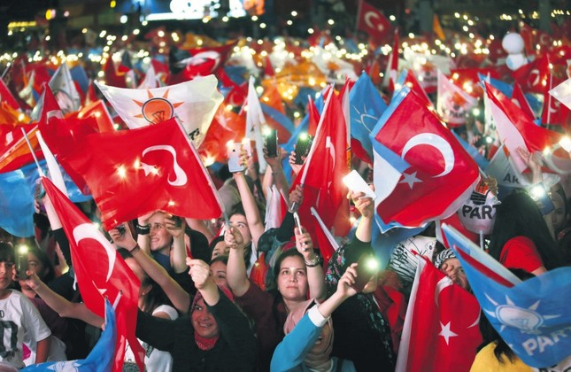 People hold Turkish and AK Party flags and celebrate Recep Tayyip Erdoğan's and the AK Party's victory in the June 24 elections, Ankara, early Monday.