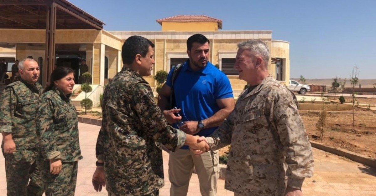 This photo shared on Twitter by @mustefabali on July 22, 2019, shows U.S. Gen. Kenneth McKenzie (R) shaking hands with SDF leader Mazlum Abdi.