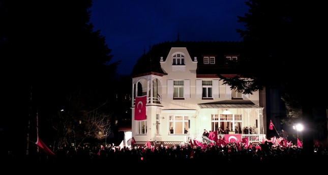 Turkish people gathering at the residence of Turkey's consul general in Hamburg to protest the German gov't after Turkish Foreign Minister Mevlüt Çavuşoğlu's meeting on the upcoming referendum in Hamburg was cancelled by German officials, March 7.