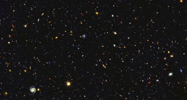 This photo encompasses a sea of approximately 15,000 galaxies — 12,000 of which are star-forming — widely distributed in time and space. (NASA/ESA Photo)