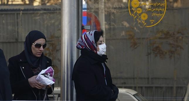 An Iranian woman wears a mask as she walks on a street in Tehran, Iran, Dec. 17 2017. (EPA Photo)