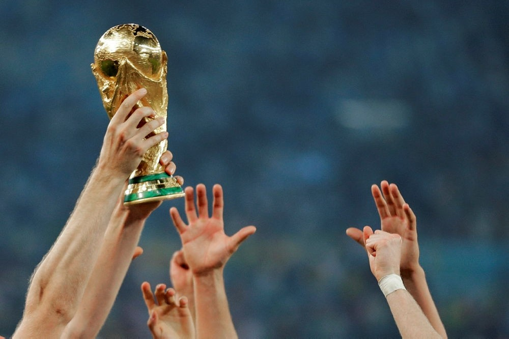 German players reach out to touch the trophy after the World Cup final soccer match between Germany and Argentina at the Maracana Stadium in Rio de Janeiro, Brazil.(AP Photo)