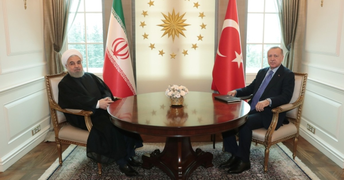 President Recep Tayyip Erdou011fan (R) and Iranian President Hassan Rouhani (L) pose before their meeting at the Presidential Palace in Ankara on September 16, 2019. (Presidential Photo Service / Murat u00c7etinmu00fchu00fcrdar via AA)