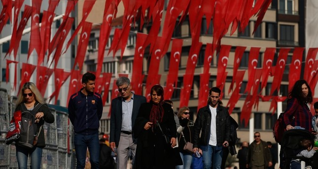 People walk in Taksim Square in Istanbul, Turkey on Tuesday, Nov. 19, 2019.  (AP Photo)