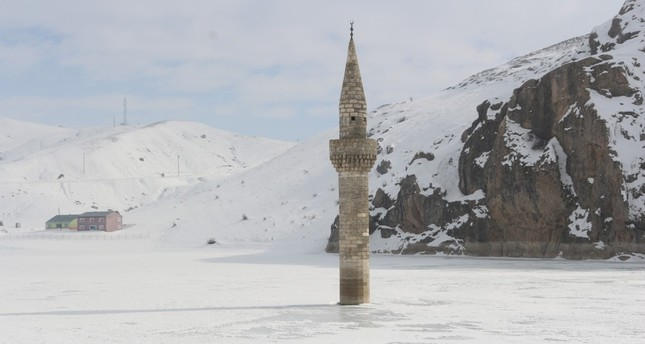 Minaret stands alone on frozen lake in eastern Turkey