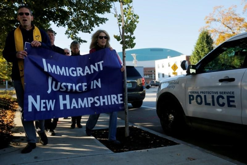 Demonstrators hold an ,Interfaith Prayer Vigil for Immigrant Justice, outside the federal building, where Christians who fled Indonesia decades ago & overstayed their visas in the US must check-in with ICE, in New Hampshire, Oct. 2017 (Reuters Photo)
