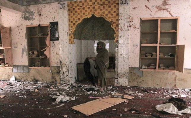 A Pakistani examines the site of Friday's bomb explosion inside a mosque in Quetta, Pakistan, Saturday, Jan. 11, 2020. (AP Photo)