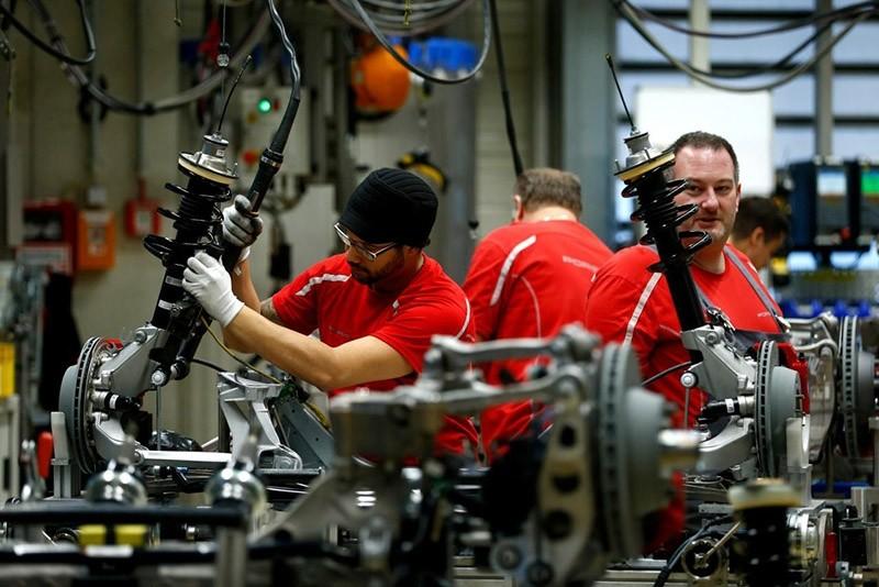 Employees of German car manufacturer Porsche work chassis at the Porsche factory in Stuttgart-Zuffenhausen, Germany, January 26, 2018. (Reuters Photo)
