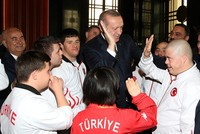 Erdoğan, futsal team with Down syndrome, hit it off