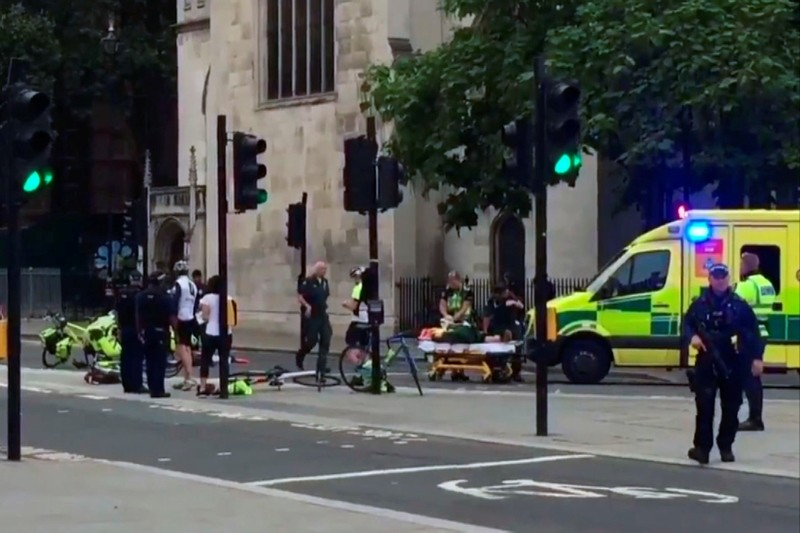 n this frame grab provided by UK Newsflare, emergency services attend the wounded after a car crashed into security barriers outside the Houses of Parliament in London, Tuesday, Aug. 14, 2018. (AP Photo)