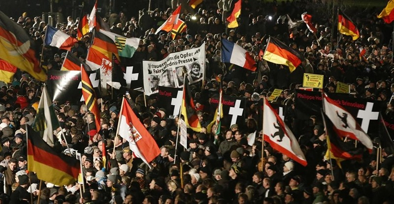 Europeans Against the Islamisation of the West (PEGIDA) hold flags during a demonstration in Dresden Jan. 12, 2015 (Reuters File Photo)