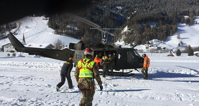 handout photo shows resucers evacuating some 100 tourists and hotel workers from a four-star mountainside hotel and a nearby guesthouse in northern Italy (EPA File Photo)