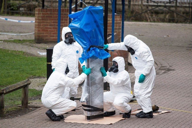 Army officers remove the bench, where Sergei Skripal and his daughter Yulia were found, in Salisbury, Wiltshire, Britain, 23 March 2018 (reissued 09 August 2018). (EPA Photo)