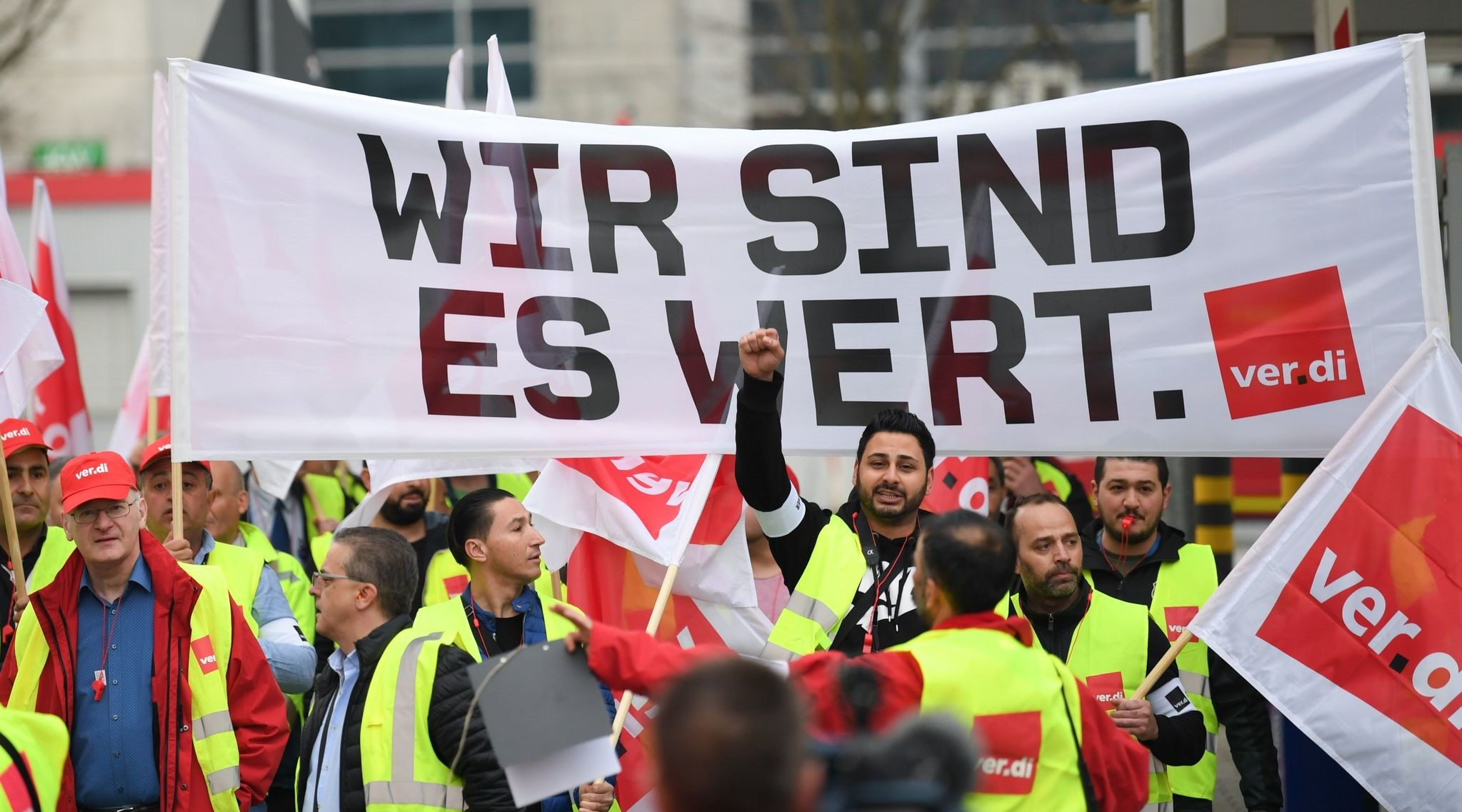 Workers hold a banner reading u201cWe are worth itu201d during a demonstration as part of a u201cwarning strikeu201d called by German union Verdi, outside Frankfurt am Mainu2019s airport, Germany, April 10.