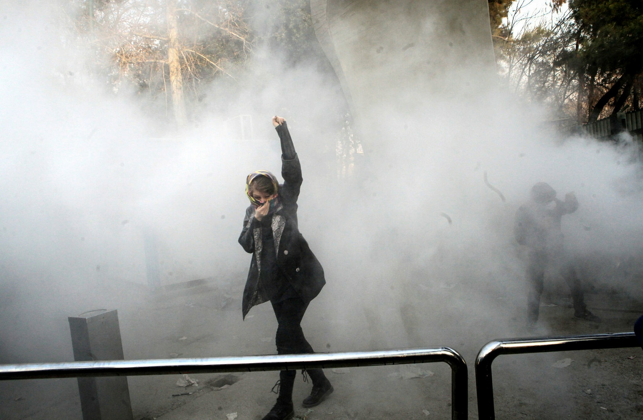 Iranian students clash with riot police during an anti-government protests around the Tehran University in Tehran, Iran, 30 December 2017. Media reported on 01 January 2018 that the anti-gov't protests in Iran are continuing. (EPA File Photo)