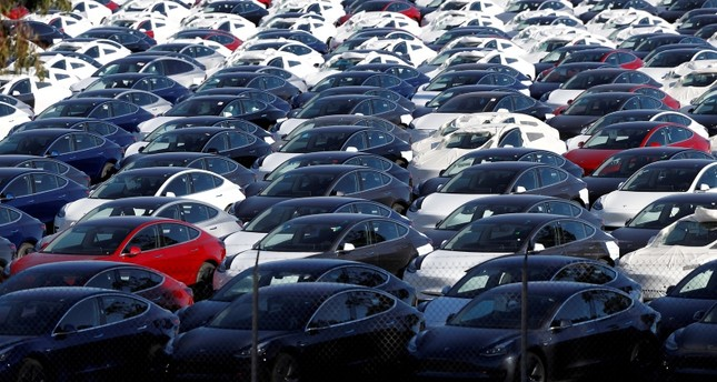 A parking lot of predominantly new Tesla Model 3 electric vehicles is seen in Richmond, California, U.S., June 22, 2018. (Reuters Photo)
