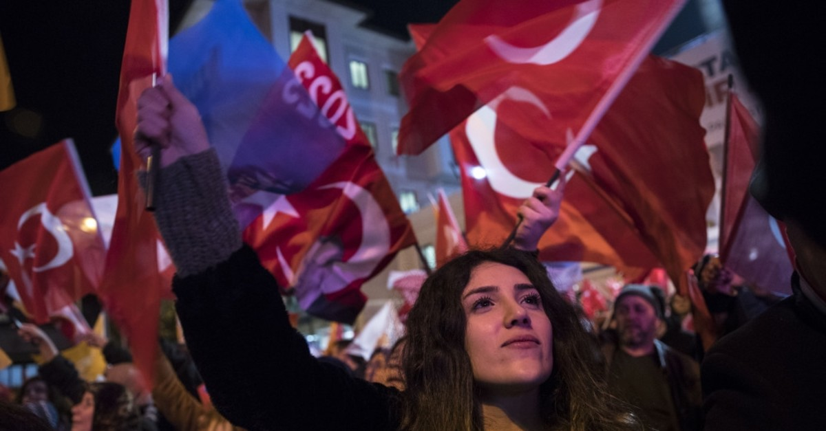 A young girl waves a Turkish flag during election celebrations in front of the AK Party building in Istanbul, April, 1, 2019.