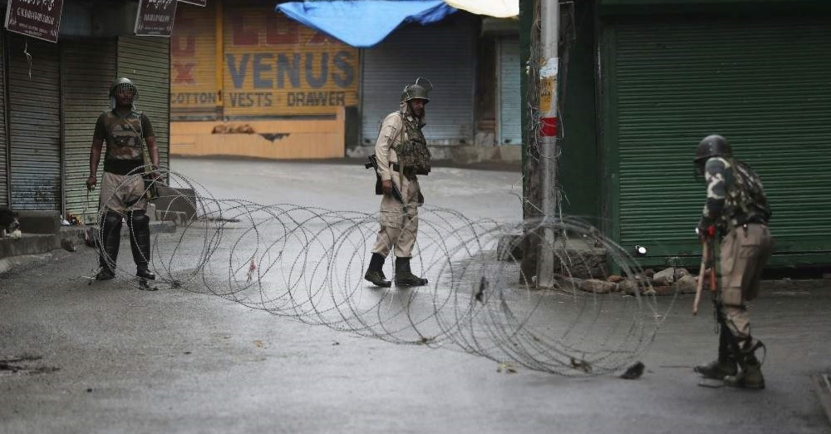 Indian paramilitary soldiers close a street using barbed wire in Srinagar, Kashmir, Aug. 10, 2019. AP